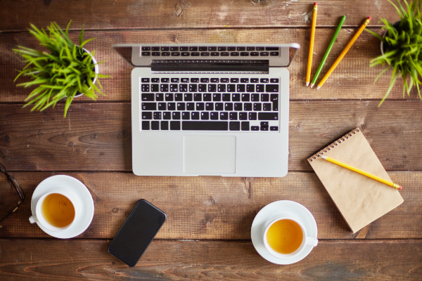 Laptop, cellphone and other business objects on workplace