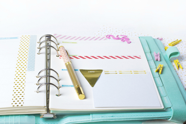 colorful paper binder clips palm and flamingo shape on white table background with washi tape.