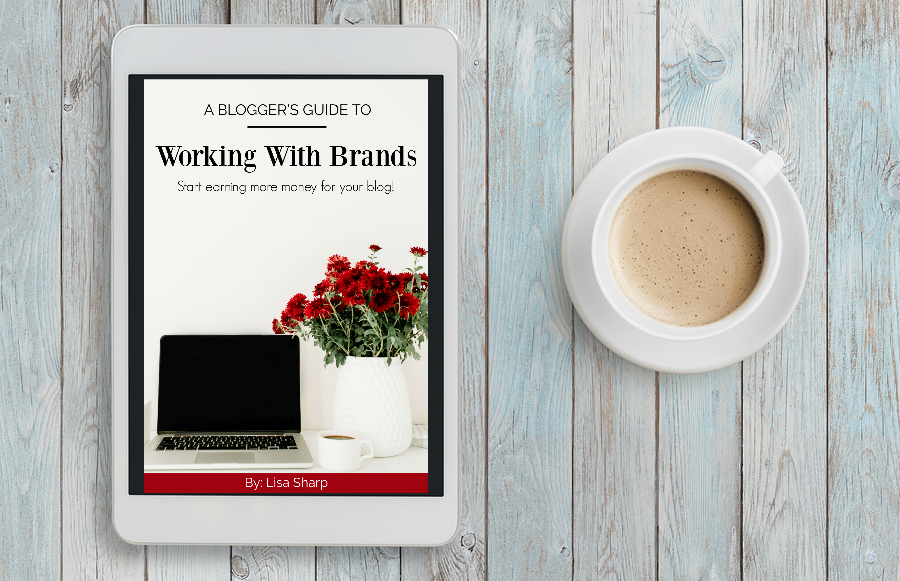 tablet with working with brands book on it and cup of coffee