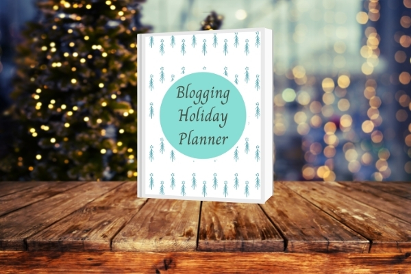 blogging holiday planner on table with christmas background